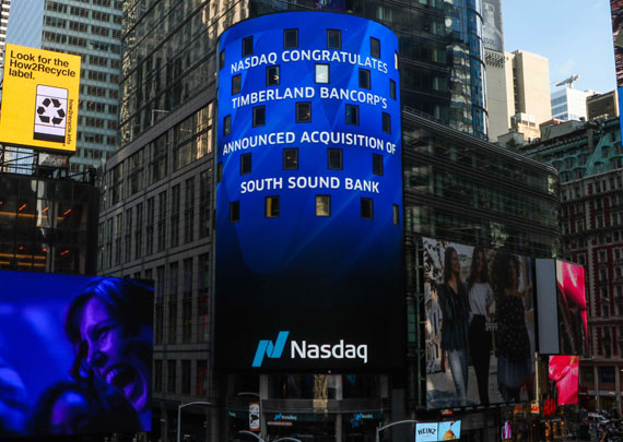 "NASDAQ board in Times Square reads ""NASDAQ congratulates Timberland Bancorp's announced acquisition of South Sound Bank"""