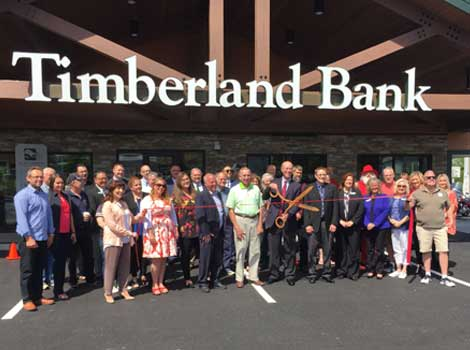 Employees and friends at the ribbon cutting of Timberland's new branch in Edgewood